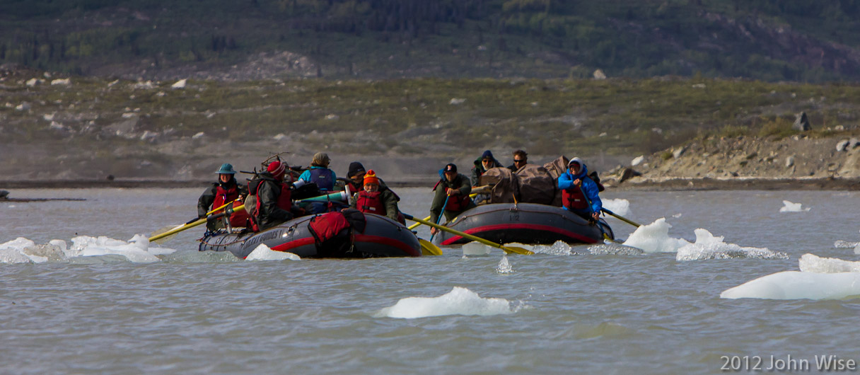 Two of our rafts threading the icebergs on their way into Lowell Lake. Kluane National Park Yukon, Canada