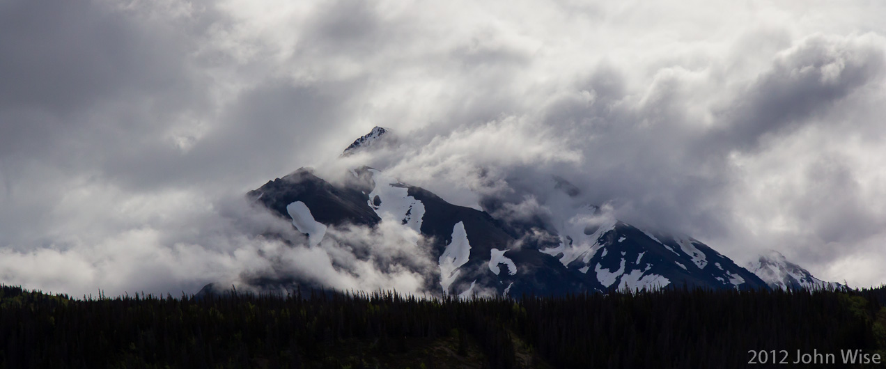 Clouds quickly come and go around the mountain tops on the Alsek River in Kluane National Park / Yukon, Canada