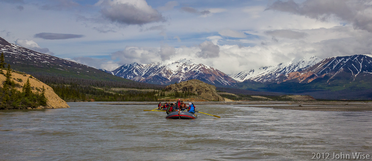 Looking back up river at two rafts following our lead on the Alsek River in the Yukon, Canada