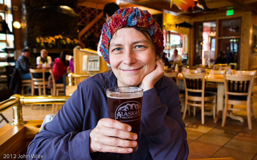 Caroline Wise enjoying her first beer in Alaska, which was better than the first bear we saw enjoying her!