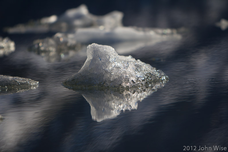 Piece of iceberg slowly floating on a journey to somewhere. Kluane National Park Yukon, Canada
